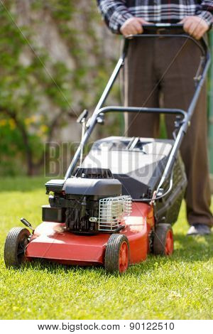 Senior Man Mowing Grass