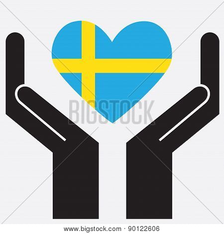Hand showing Sweden Flag.