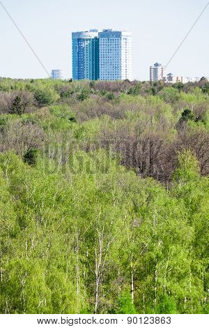 Modern Apartment House And Green Forest In Spring
