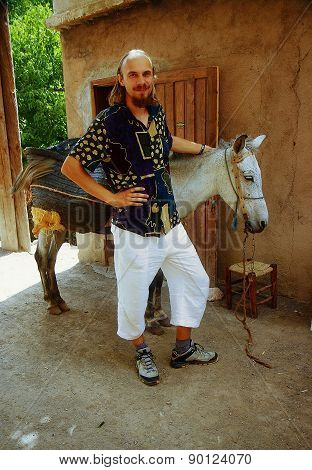 Man With Moroccan Donkeys On Travel In Morocco.