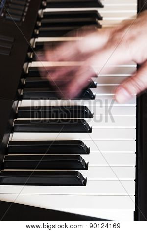 Musician Playing Music On Synthesizer Close Up