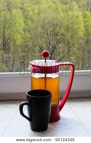Tea Kettle And Mug On Home Windowsill