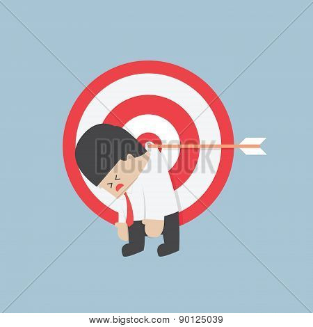 Businessman Hanging On The Target