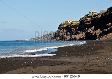 City On A Cliff Over Black Sand Beach