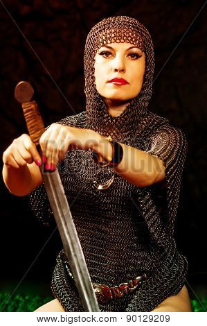 young woman model in viking armor with sword