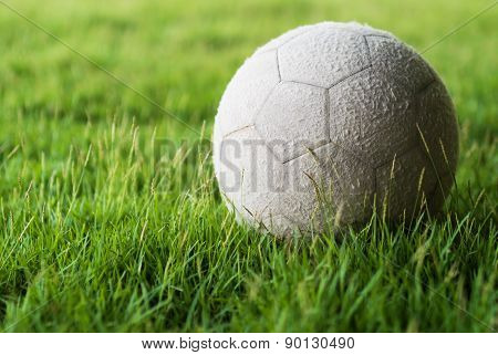 Football On Green Grass With Soft Light