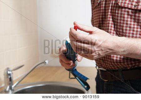 Plumber With Caulking Gun