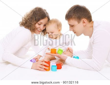 Family Having Fun Together, Parents And Baby Playing With Colorful Toys