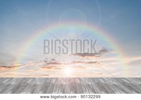 Old Wooden Texture And Rainbow  With Lens Flare In Blue Sky Background
