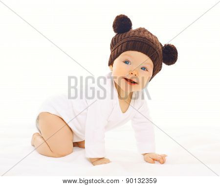 Portrait Positive Baby In Knitted Brown Hat Crawls