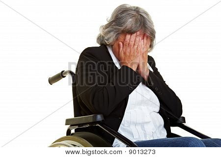 Sad Elderly Wheelchair User