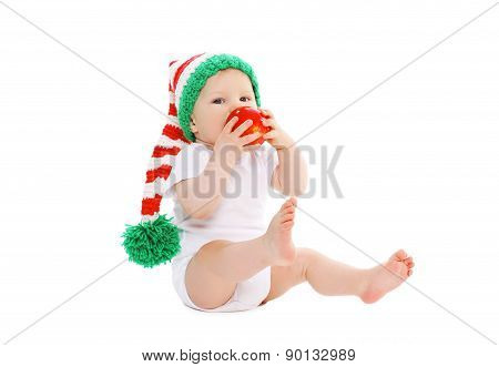 Baby In Knitted Hat With Red Apple