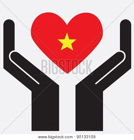 Hand showing Vietnam flag in a heart shape.