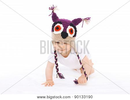 Portrait Of Baby In Knitted Hat Crawls On A White Background