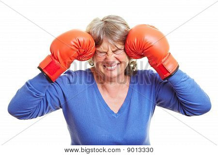Woman Pressing Boxing Gloves To Head