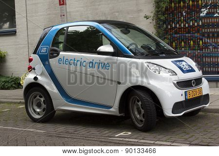 Electric Car At A Charging Point In The Streets Of Amsterdam