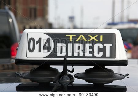 Taxi Sign On A Cab At The Central Station In Amsterdam