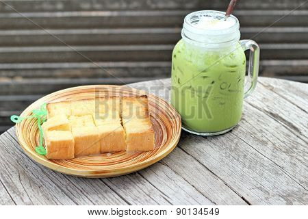 Bread, Butter, Topped Milk And Green Tea.