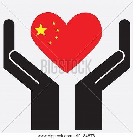 Hand showing China flag in a heart shape.