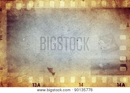 Film negative frames on brown background