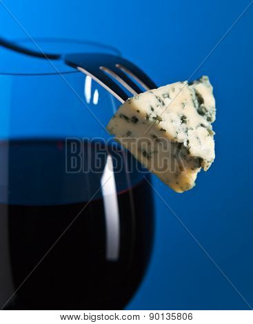 Cheese And Red Wine On Blue Background