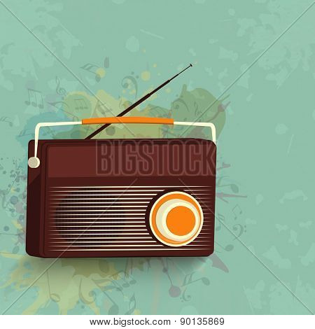 Stylish portable radio on musical notes decorated grungy background.