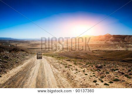 car In A Desert Road