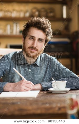 Man Sketching On His Notebook