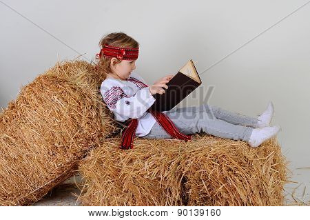Ukrainian Girl In National Dress With A Book