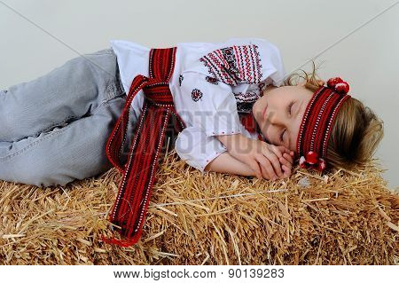 Ukrainian Girl In National Dress And Jeans Sleeping In The Hay.