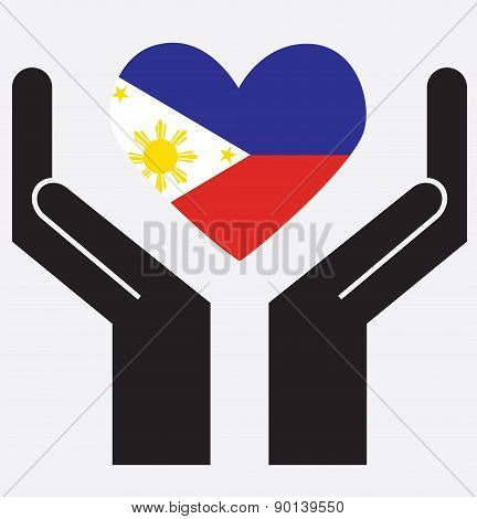 Hand showing Philippines flag in a heart shape.
