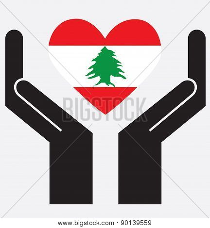 Hand showing Lebanon flag in a heart shape.