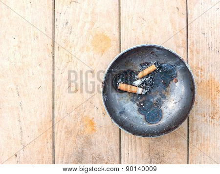 Cigarette And Metal Ashtray