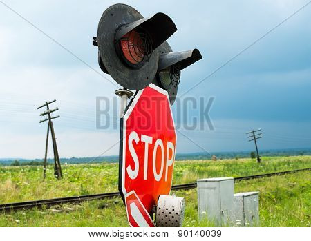 Traffic Lights And Signs At The Railroad Crossing