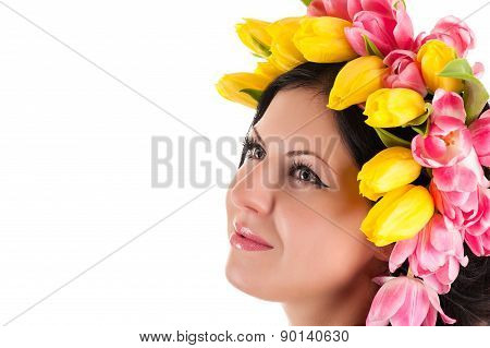 beautiful woman with tulips on the head looking up