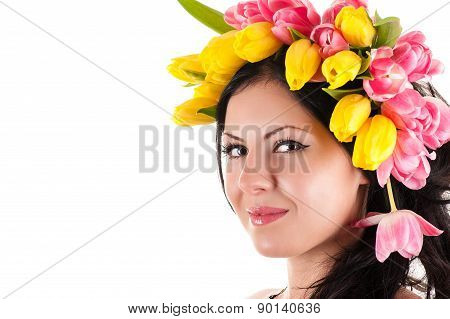portrait of a beautiful woman with tulips on the head