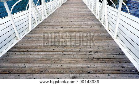 Wooden Floor Bridge And White Railing Over Danube River