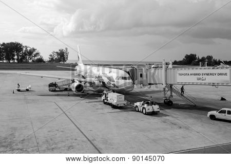 PHUKET - OCTOBER 25, 2011: Bangkok Air jet airplane docked in Phuket International Airport, Thailand. Bangkok Airways Public Company Limited is a regional airline based in Vibhavadi Rangsit Road
