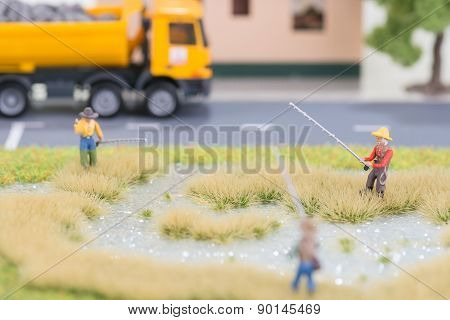 Miniature Fishermen Near Road