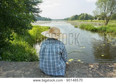 Angling Boy With Fishing Rod On Concrete Bridge Back View