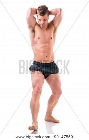 Full body shot of shirtless muscular young man