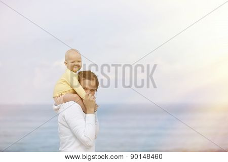 Mother And Adorable Smiling Baby Cuddling