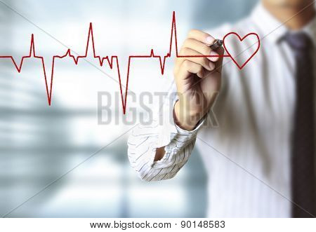 man drawing heart and chart heartbeat