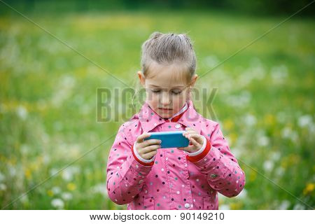 Girl Reviewing Photos She Made With Smart Phone