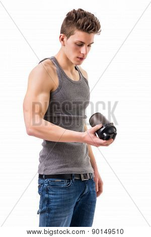 Attractive young man holding protein shake bottle. Isolated