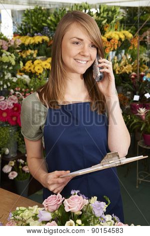 Florist In Shop Taking Phone Order For Delivery