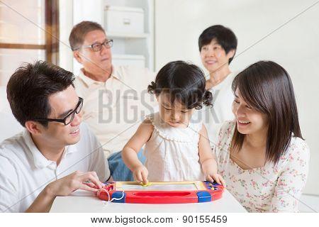 Happy family portrait. Asian multi generations having fun at home.