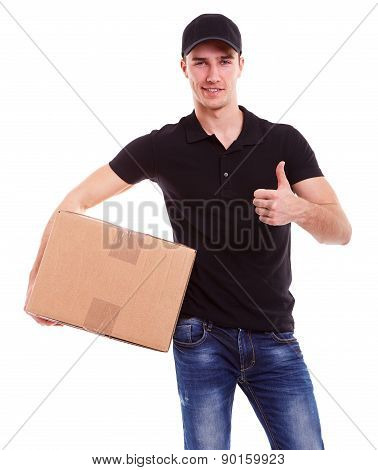 Smiling Delivery Man Holding A Cardboard Box And Makes A Gesture Ok