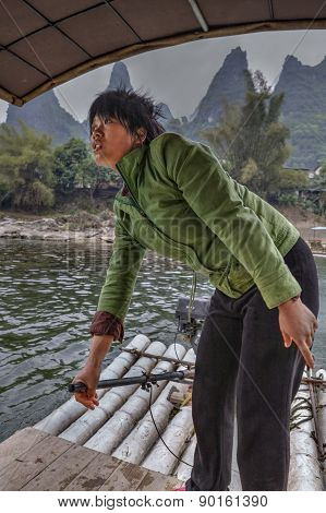 Chinese Woman Working Ferryman On The River Lijiang, Guangxi, China.