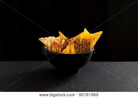Fried Spicy Lavash Chips In Black Tureen